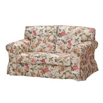 Divano DAIANA in tessuto con fantasia floreale e seduta e schienale imbottiti.á Struttura solida e confortevole.
