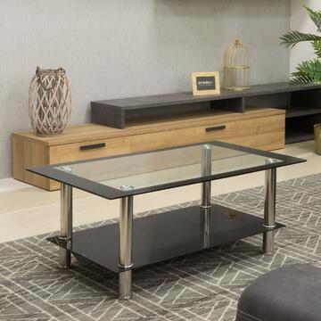 Tavolino rettangolare in vetro nero con zona centrale del piano tavolo trasparente. Il ripiano separato per le riviste ti aiuterà a organizzare e tenere in ordine tutte le tue cose.